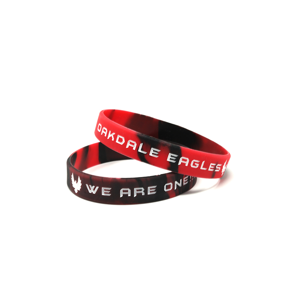 Stack of black and red segmented wristbands with messages.