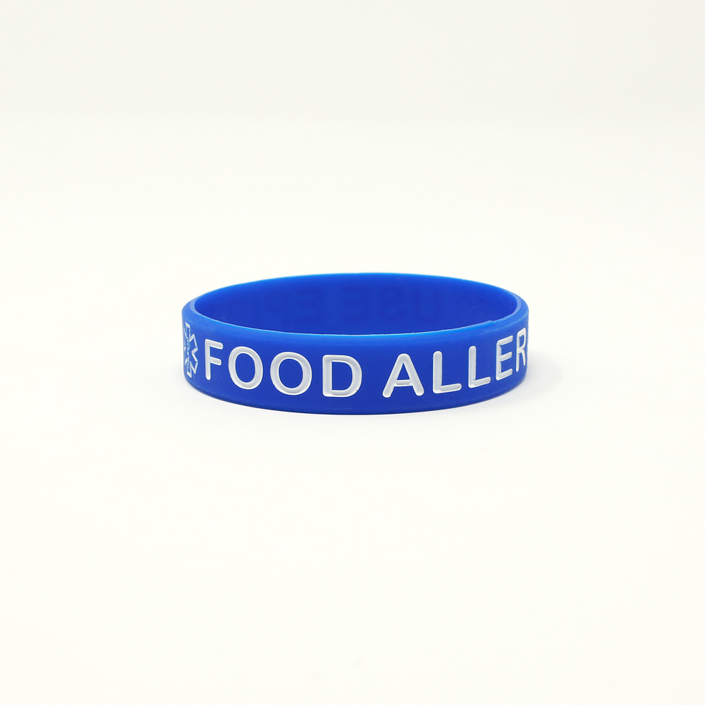 A blue printed wristband that says food allergy.