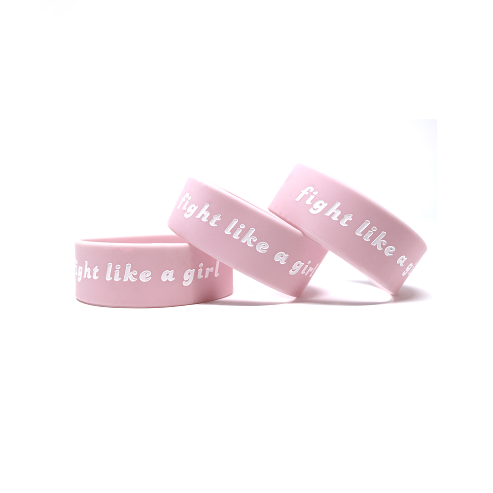 Pink 1 inch wristband that says fight like a girl.