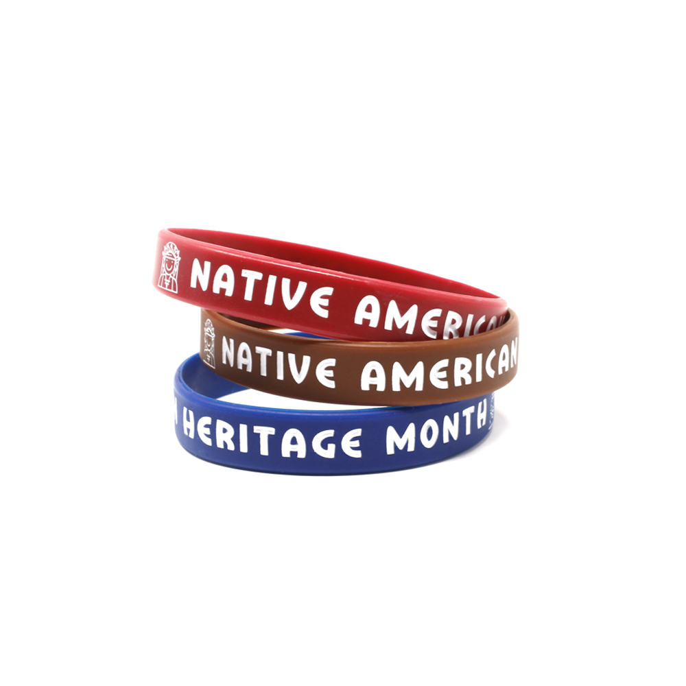 Red, brown, and blue Native American heritage wristbands.