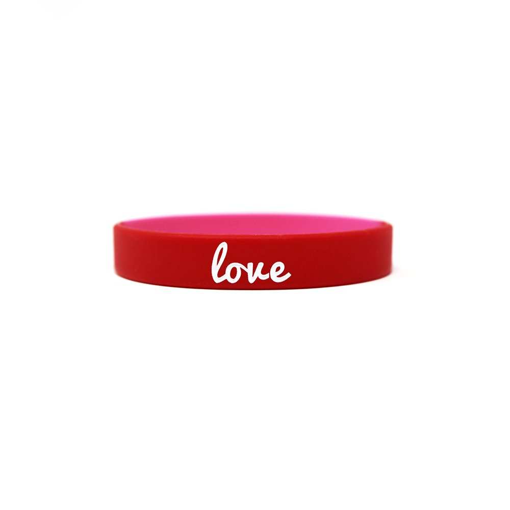 A printed red wristband that says love.