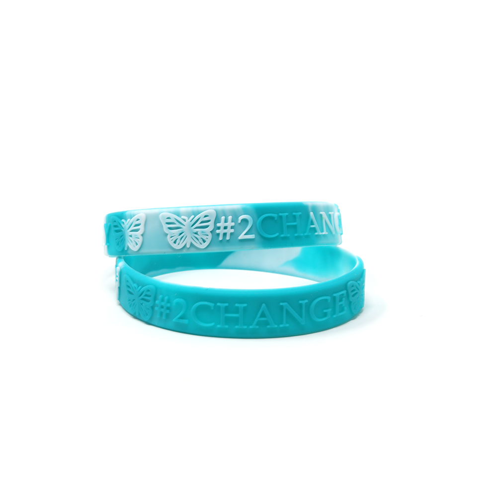 White and teal embossed wristbands that say 2 change.