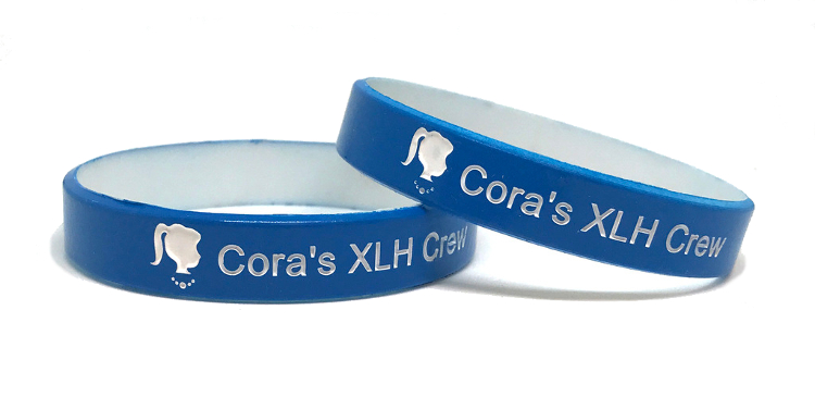 Two blue color coat wristbands with personal messages.