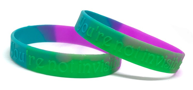 A custom segmented wristband with a personal message saying you're not invisible.