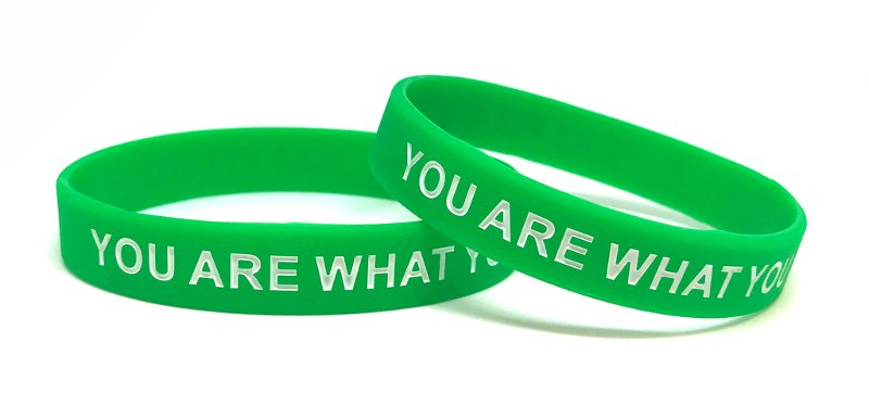 Green ink-injected wristbands with personal messages saying you are what you are.