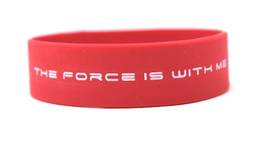 Red silicone wristband with the message the force is with me in white letters.