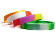 A stack of segmented blank wristbands.