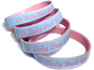 4 color coat wristbands with personal messages saying baby dust.