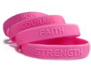 4 pink embossed custom wristbands with personal messages.