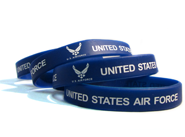 Blue printed wristbands with a personal message saying United States Air Force.